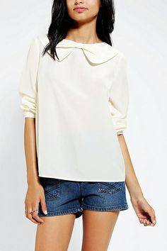 The bow collar on this silky blouse is just too cute.