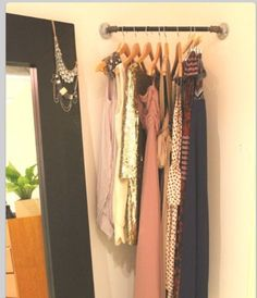 A corner rod to hang outfits on