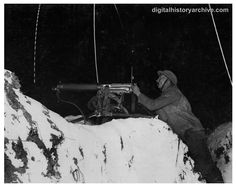 WWI, 1918 - British machine gunner firing on German trenches near Cambrai, France on January 14, 1918. Despite public opinion, artillery, not machine guns caused the most casualties in World War I.