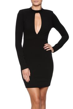 Black long sleeve bodycon dress with a mock neck, front and back cut out and a button back closure.   Long Sleeve Cutout Dress by Solemio. Clothing - Dresses - Long Sleeve New York City Manhattan, New York City