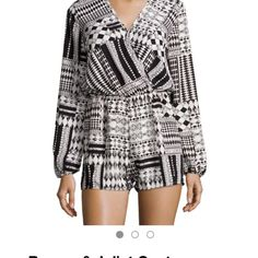 Romeo & Juliet Couture Romper NWT's  Cream and black Romeo & Juliet Couture long sleeve geometric print romper. Blouson bodice, elasticized waist, relaxed shorts, straight hem. Polyester. Made in the USA. Hand wash Romeo & Juliet Couture Dresses