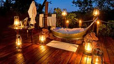 """Romantic outdoors, The Suites, Sanctuary Baines' Camp, Botswana. I love the shape of this """"Tina"""".would love to incorporate this into my backyard sanctuary. Outdoor Bathtub, Outdoor Bathrooms, Outdoor Showers, Hotel Bathrooms, Luxury Bathrooms, Outdoor Spaces, Outdoor Living, Outdoor Decor, Indoor Outdoor"""