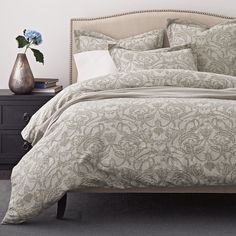 The Verona Duvet Cover is landscaped with a flourishing vining botanical pattern inspired by a Renaissance textile.