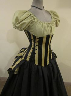 corset check, stripes check, bustle thing check. yup - crossing all sorts of styles but it looks like a fun outft.