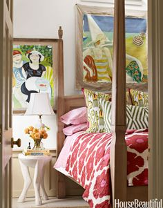 A guest bedroom in designer Ken Fulk's Provincetown, Massachusetts, house, is vibrant with color — John Robshaw bedding, paintings by Marion Vinot. Ari side table, Oly Studio.   - HouseBeautiful.com