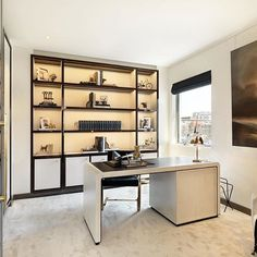Keeping it simple and sophisticated in this Knightsbridge apartment study. Our carpet perfectly compliments the stylish luxury interior. #Colbourns #handtufted #carpet #installation #interior #interiordesign #interiorstyling #knightsbridge #bespoke #madetoorder #luxuryhomes #luxuryinteriors