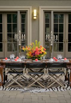 Luxurious table setting, an eclectic mix of styles under a traditional setting, a bright arrangement makes it work!