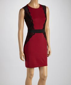 Featuring pretty lace panels and trendy color blocking, this sheath dress will be a hit. Ideal for office-to-evening wear, it promises to be a staple in any fashion-forward wardrobe.Measurements (size M): 34'' long from high point of shoulder to hem77% polyester / 18% rayon / 5% spandexMachine wash; hang dryImported