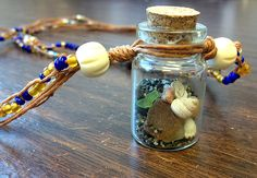 Beach in a Bottle Necklace | Loose Ends Find beach bottles, mini glass bottles, beach glass. charms, pearls & chains at www.eCrafty.com #ecrafty #beachbottlenecklace #diycrafts