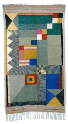 Bauhaus rug. Benita Koch-Otte was a German Bildwirkerin and textile designer who was one of the first students at the Bauhaus and an instructor there. You can see the influence of instructors Paul Klee and Kandinsky in many of her patterns and color palettes, like this one