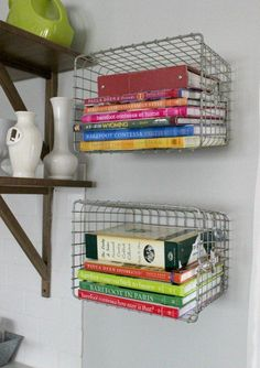 Hang metal baskets on the wall for book storage. 20 Clever DIY Storage Solutions