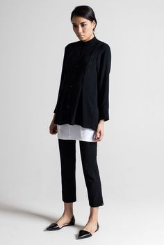 Black leather pocket sweater, white blouse, black crop pants, black pointy toe flats