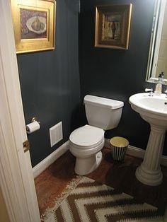 dark grey bathroom - do we run wood flooring into the powder room & eliminate grey tile?