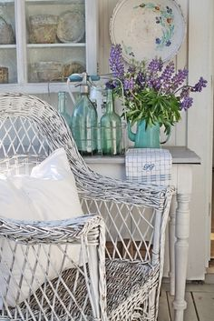 LOve that wicker...vintage table in back and I think lavender in blue pitcher....:-)