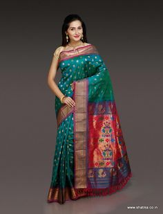 This Amba Rama Green Paithani Silk Saree in dull pink border with bootis creates the retro design in modern weave. This paithani silk saree with beautiful Zari work makes this drape a unique collection. This time tested combination of green and pink on paithani silk is sure to make your day filled with sweet memories.