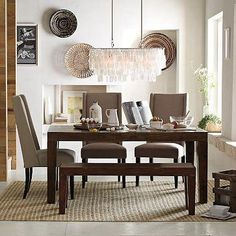 Family style. Gather 'round for potluck dinners, holiday feasts and friendly dinners. The solid lines of the rustic Carroll Farm Dining Table are reinterpreted for today, with an expansive,