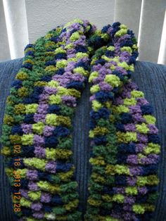 A personal favorite from my Etsy shop https://www.etsy.com/listing/123991857/african-violet-large-pom-pom-scarf