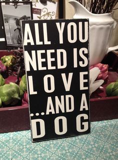 "All You Need Is Love and a Dog - Hand Painted Wood Sign -5.5""x10"". $13.00, via Etsy."