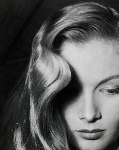 Veronica Lake, american stage and film actress, also well known for her peek-a-boo hairstyle