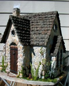 My idea: Take a Barbie house or pony castle and apply small stones to it and let moss and vines grow on it so it looks kind of like this.  Bird feeder.