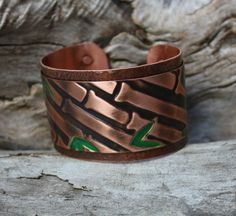 This is a handmade Copper Cuff designed and made by Joan of 2 Women on Fire.  It is signed on the reverse.  $60 on eBay.