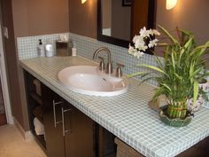 tiled bathroom counter with undermount sink | glass tile countertop and backsplash. Tiled counters require a sink ...