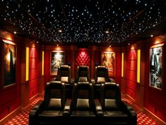 Movie Poster Acoustic Panels - prefer the eyeball downlights on movie poster frames than the wall mount light. Use sconce between posters, on pillars?