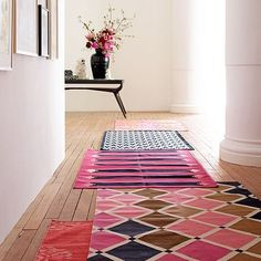 For many years, Madeline Weinrib has been designing stunning cotton flat weave rugs, and her contemporary translations of traditional designs paired with rich colors has been widely copied. There is nothing like her originals. If you want to get started, I would recommend one of her runners. These are on the lower end of her price spectrum and make a huge statement as you come through the door (and I have two. LOVE them.).