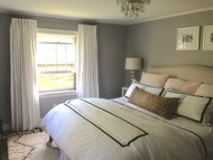 Benjamin Moore Balboa Mist paint color. like the gray walls and off white window treatents. mixed with cream headboard and white linens