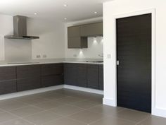 Stylish dark grey doors match modern interiors perfectly. JB Kind's Eco Grigio painted flush door. #interiors