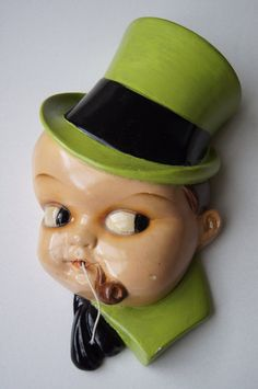 Vintage Googly Eye Chalkware Boy String Holder St. Patrick's Day Irish, via Etsy..