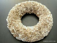 Bookpage wreath made with circles from 2 inch punch and glued on a foam wreath base