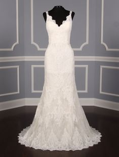 This Pronovias Osera wedding dress is such an incredible chantilly lace gown. You will definitely 'wow' your guests when you walk down the aisle in this exquisite dress on your wedding day! #weddingdress