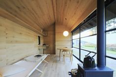 The minimal interior of a MUJI Wooden Hut, a prefab home in Japan.