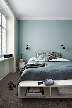 Beautiful blue bedroom design with charming wall lamps