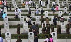 North Koreans pay their respects to soldiers who died at the cemeteries of fallen fighters of the Korean People's Army (KPA) in Pyongyang, North Korea marking the 60th anniversary of the signing of the armistice that ended hostilities on the Korean peninsula.