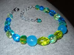 "Beaded bracelet, in a color scheme based on my ""Stellar"" scheme on IMVU. Blue, green, and teal :)"