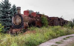 train graveyard Poland n places the rails upon which they stand are visible, while elsewhere abandoned locomotives are coupled end-to-end amid high grass and densely overgrown foliage. - See more at: http://www.urbanghostsmedia.com/2014/04/urban-explorer-photographs-abandoned-train-graveyard-poland/#sthash.qNwmvK1R.dpuf