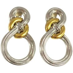 Preowned Large 1980s Givenchy Earrings In Silver And Gold featuring polyvore, women's fashion, jewelry, earrings, brown, brown earrings, gold and silver earrings, preowned jewelry, 80s jewelry and clip-on earrings