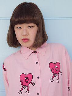 Yukika wears the Running Hearts Shirt