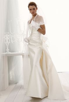 Sophisticated, chic, glamorous and Strapless mikado Bridal dress with full train, and bow.