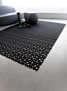 *product design, modern interiors, carpets* - RIVER ROCK CARPET BY BEV HISEY. The River Rock carpet is a die cut wool felt rug that reveals the flooring beneath the perforations. The smooth end of the carpet really highlights the river rocks on the other side.