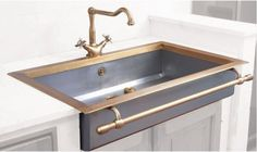 first I have seen with my desire of a towel bar across front of kitchen sink. love the undivided sink; not so much the faucet