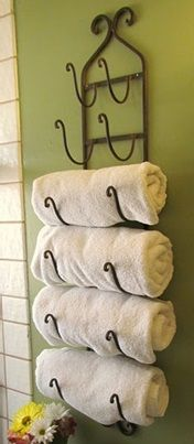 "Reuse Wine Rack for a neatly organized Towel Rack to be put on display...Click on the Image for more information on ""DIY Bathroom Towel Hooks and Racks"" by Kitchen Bath Trends"