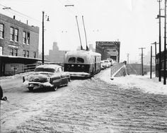 Trolley bus on Grand Ave from Desplaines Ave/Trolley bus on Grand Ave from Desplaines Ave A CTA trolley (electric) bus makes its way east in the snow in January 1957. The viaduct/bridge it's crossing is no more, but once allowed passage over railroad tracks just west of the North Branch of the Chicago River.