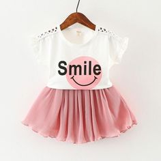 Smiling Face Printed Lace Cutout Short Sleeve Top & Pleated Skirt Set in Pink for Baby Girls Outfits Niños, Cute Girl Outfits, Kids Outfits, Baby Outfits Newborn, Toddler Outfits, Baby Girl Fashion, Kids Fashion, Baby Suit, Matching Family Outfits