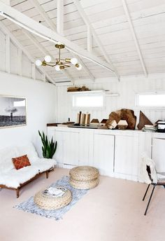 adorable with exposed beams and white wood paneling