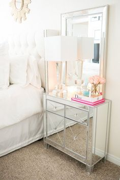 Nightstand items. Lamp Mirror Books Candles Flowers