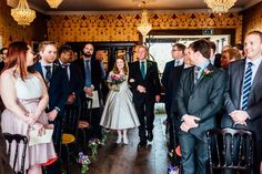 Bride Frankie wore a 1950's inspired, colourful polka dot dress by 'Oh My Honey' for her geek-chic and reto inspired wedding. Photography by Anna Pumer.