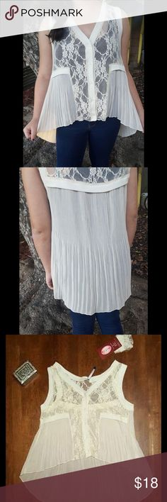 One hour❤️Delicate Lace & Ivory Button Down Blouse Sweet button down blouse. Has pretty lace features. Hi-Low. Very soft.  SM Length: 20in (front), 27in (Back) Bust: 40in...  All of my items are shipped same day if you buy before 2 PM PST. ALL OFFERS ARE CONSIDERED.. I would love to answer any questions you have about this top, just ask below. NGE Tops Button Down Shirts